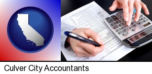 Culver City, California - an accountant at work