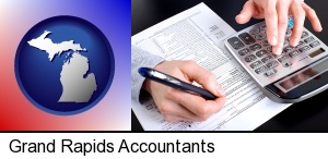 an accountant at work in Grand Rapids, MI