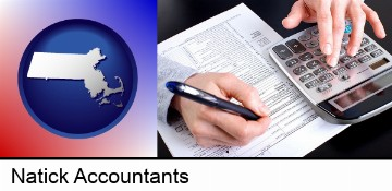 an accountant at work in Natick, MA