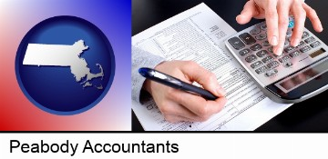 an accountant at work in Peabody, MA