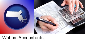 an accountant at work in Woburn, MA